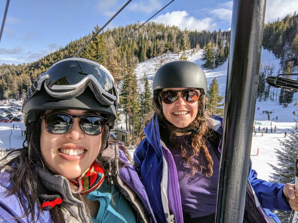 Two woman on a ski lift