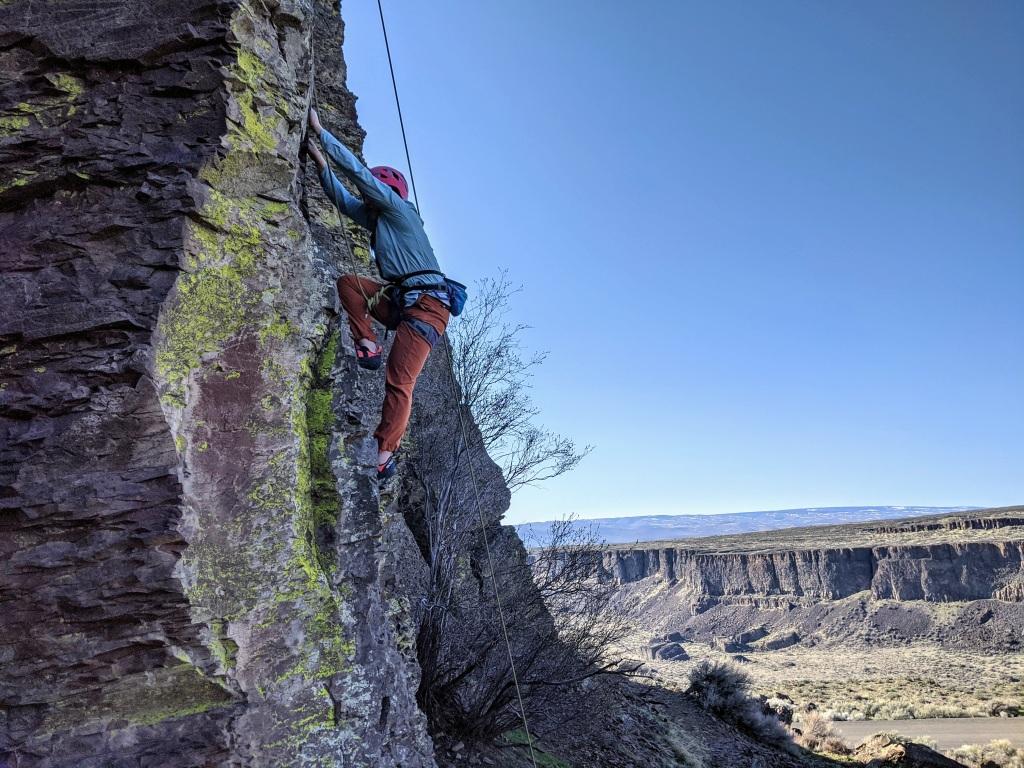 Climber climbing outside