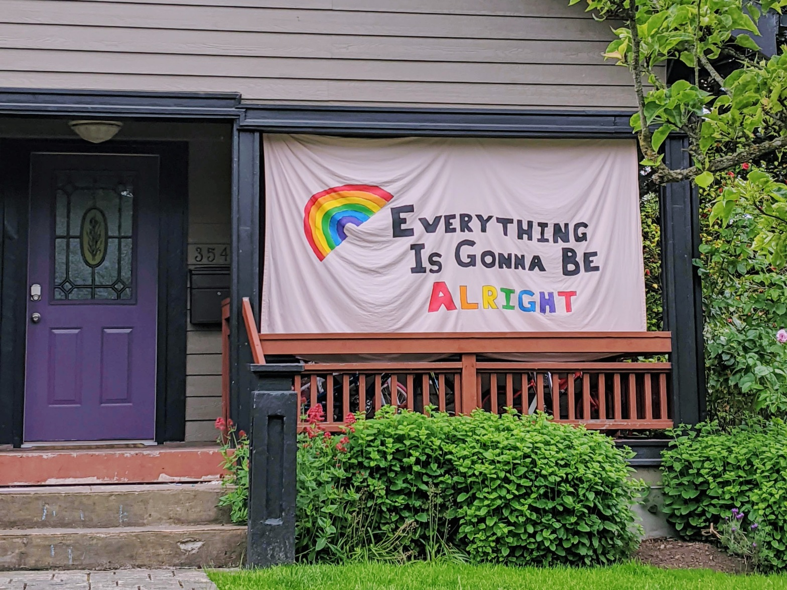 """""""Everything Is Gonna Be Alright"""" sign outside a house"""